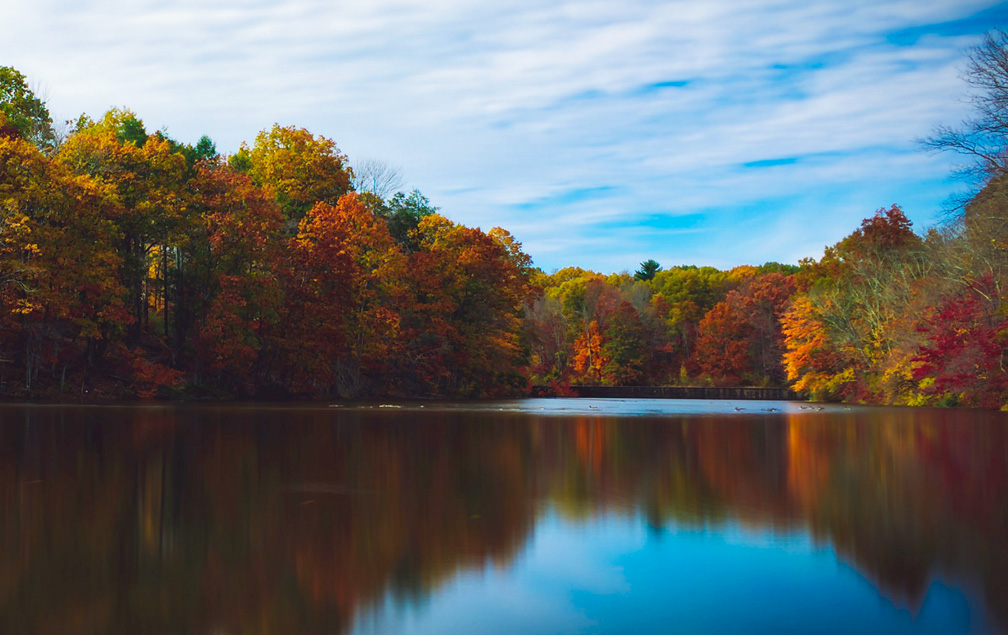 Photo: Fall color reflected in a lake